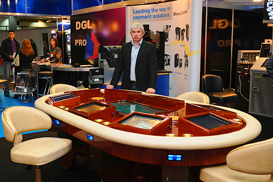 Edvins Lobins presenting Electronic Texas Hold'em poker table
